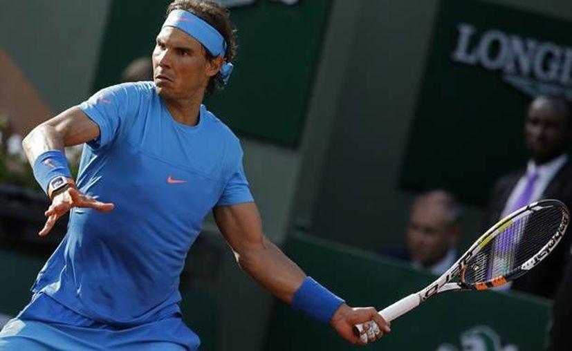 Rafael Nadal enfrentará a Novak Djokovic en cuartos de final de Roland Garros. (AP)