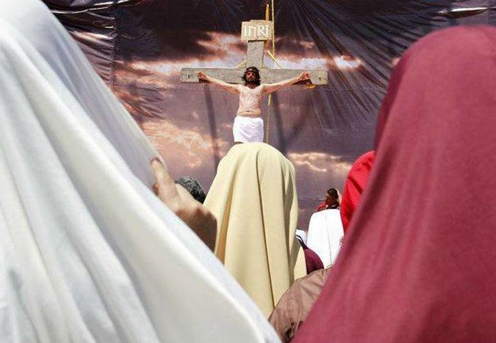 Este Viernes Santo es representativo para los fieles católicos quienes viven y participan de la pasión y muerte de Jesucristo. (Foto de Contexto/SIPSE)