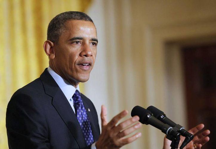 La reducción del salario de Obama supone cerca de 16 mil 600 dólares respecto a su sueldo anual de 400 mil dólares. (EFE/Archivo)