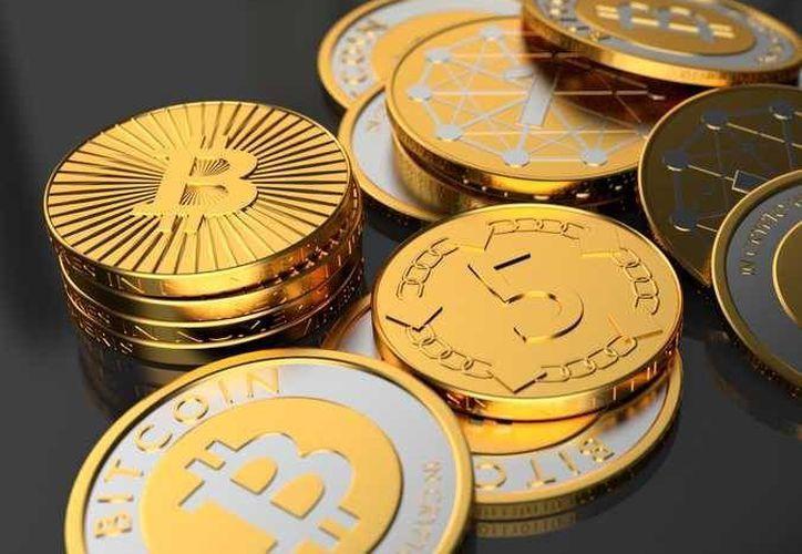 El bitcoin es una divisa electrónica que funciona como forma de pago de bienes y servicios pero sin seguir las normas habituales de las autoridades bancarias nacionales e internacionales. (Internet)