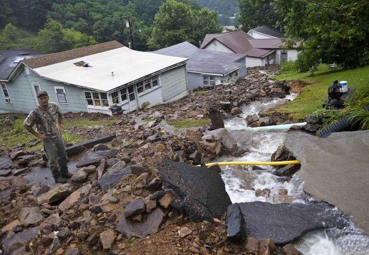 Así lucen los 44 condados de Virginia del Oeste que fueron declarados en emergencia por las inundaciones. Hay al menos 14 personas muertas. (AP)