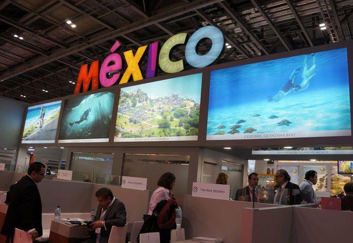 El pabellón de México en el World Travel Market en Londres es uno de los más coloridos del evento. (Notimex)