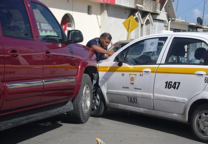 Los vehículos adheridos al Suchaa, con números económicos 1647, 473 y 461 resultaron protagonistas de los percances del día en las colonias Payo Obispo, Jardines y David Gustavo Gutiérrez Ruiz. (Redacción/SIPSE)