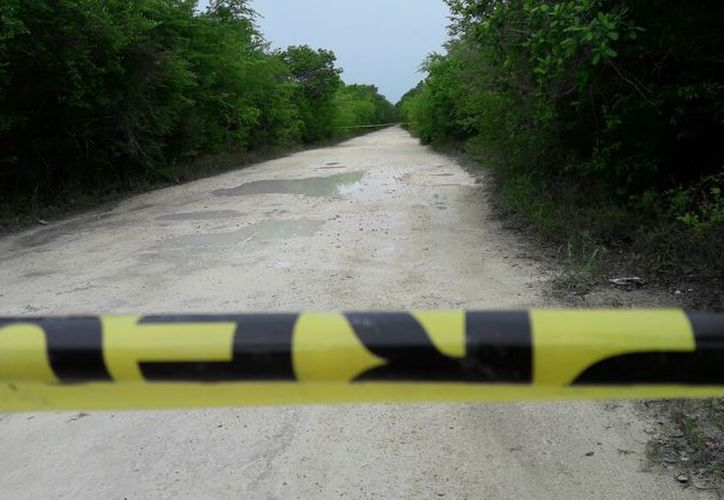 Vecinos del lugar reportaron al número de emergencias 911 el hallazgo de personas sin vida. (SIPSE)