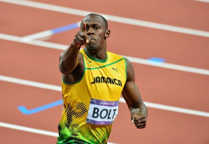 El hombre más rápido del planeta se siente listo para el Mundial de atletismo a disputarse en Moscú. (Agencias)