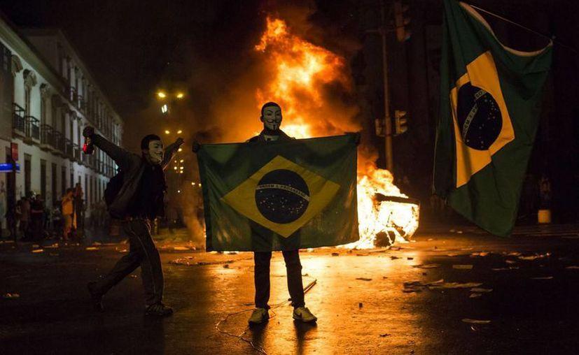 Las recientes manifestaciones exigen un ajuste de las técnicas policiacas. (Archivo/Agencias)