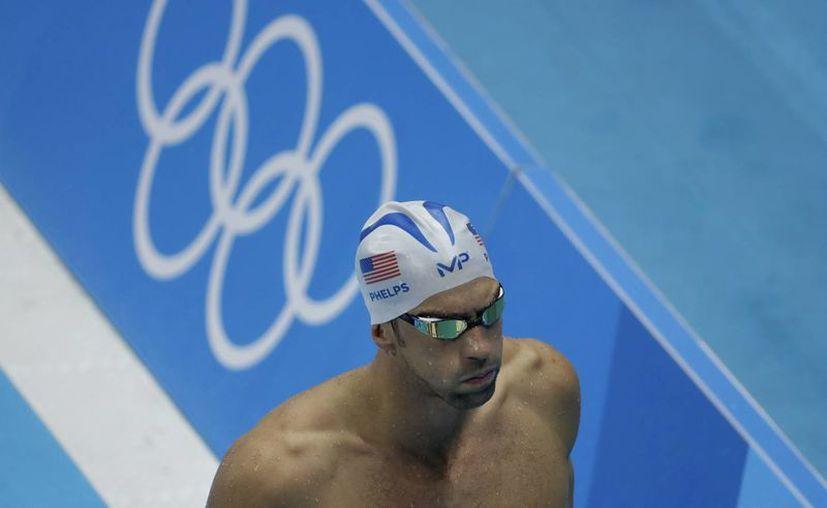 Michael Phelps durante una sesión de entrenamiento de natación antes de los Juegos Olímpicos de 2016 en Río de Janeiro, Brasil. El deportista será el abanderado de Estados Unidos. (Foto AP / Matt Slocum)