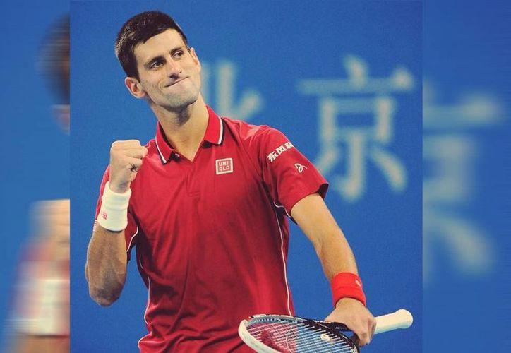 Tras su victoria en el torneo ATP de Beijin ante Tomas Berdych, Novak Djokovic mantiene en trono en el ranking mundial. (Twitter/Novak Djokovic)