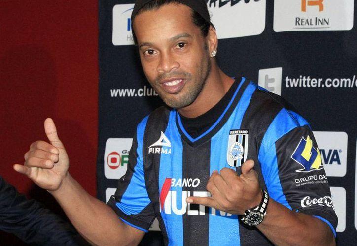 Ronaldinho confesó que no se inmuta por los insultos que ha recibido a lo largo de su carrera. (Notimex)