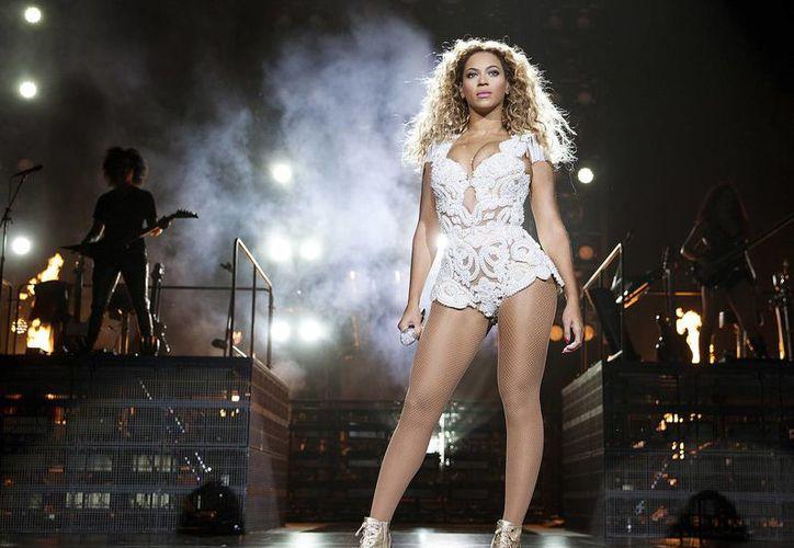 El nombre de Beyonce no solamente suena en las listas musicales, sino que ahora recorre los pasillos de Hollywood, ya que al parecer será la protagonista del estreno como director del actor Bradley Cooper. (Archivo AP)