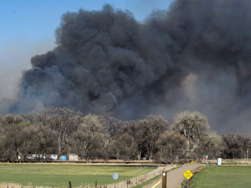 That fire has burned about 442 square miles (1,145 sq. kilometers) and is an estimated 3 percent contained. (AP)