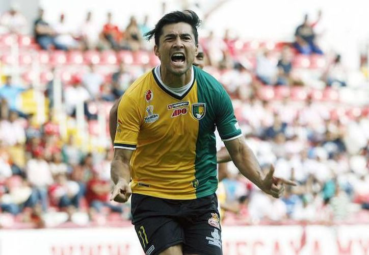 Venados mantiene su calidad de invicto en la actual temporada, además lleva 3 partidos consecutivos sin recibir gol. En la foto, Mauricio Romero festeja uno de sus muchos goles. (Milenio Novedades)