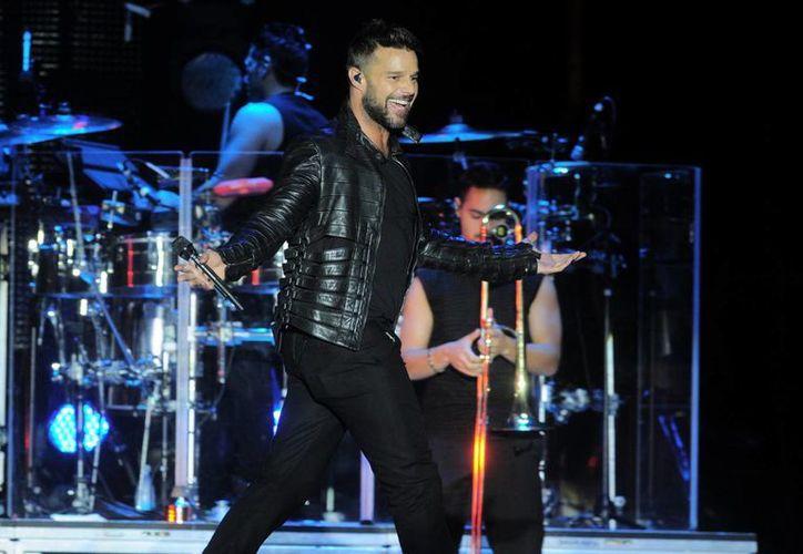 """Actualmente, Ricky Martin está metido en la producción del tema """"Vida"""", seleccionado como una de las canciones oficiales del Mundial de Fútbol Brasil 2014. (EFE/Archivo)"""