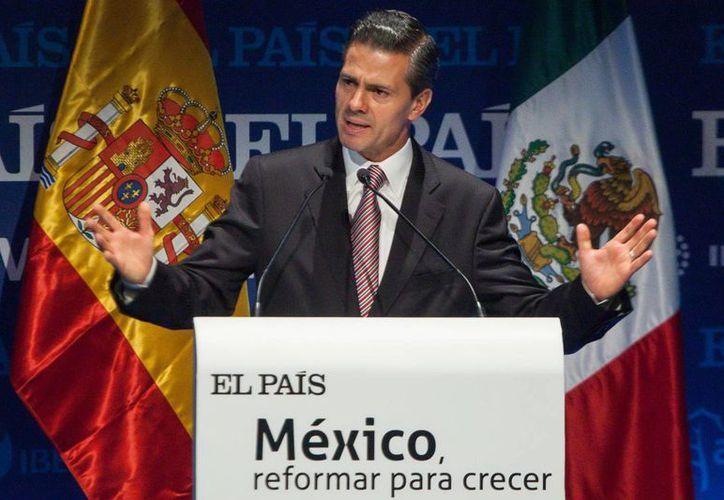 Peña Nieto durante su intervención en el foro 'México, reformar para crecer', en Madrid. (Notimex)