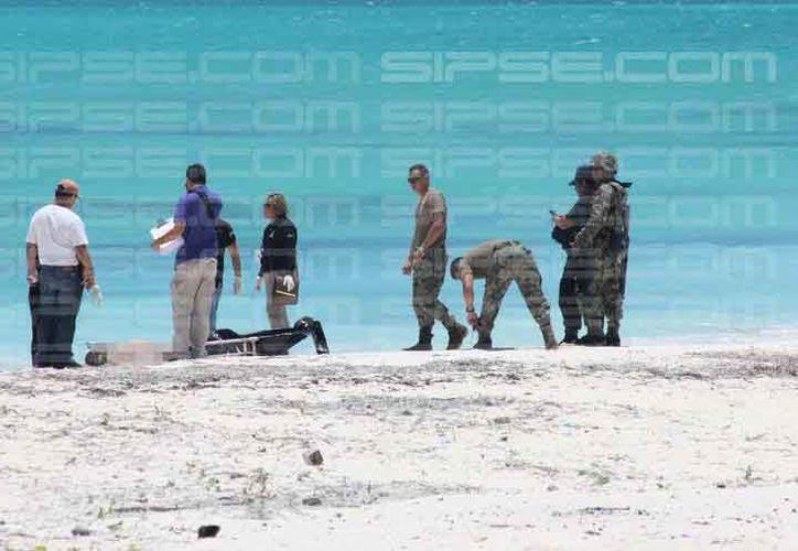Las autoridades atendieron el reporte. El cuerpo fue trasladado al Semefo. (Redacción/SIPSE)