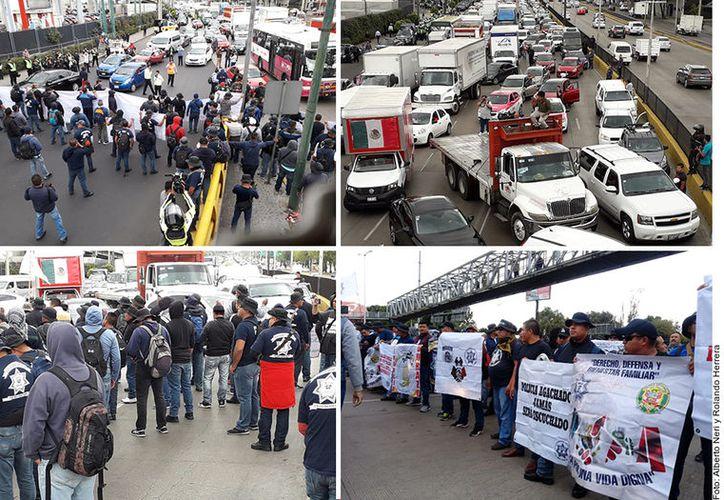 Policías federales rebeldes bloquean desde las 12:40 hrs. el Circuito Interior a la altura del acceso al Aeropuerto de la Ciudad de México. (Agencia Reforma)