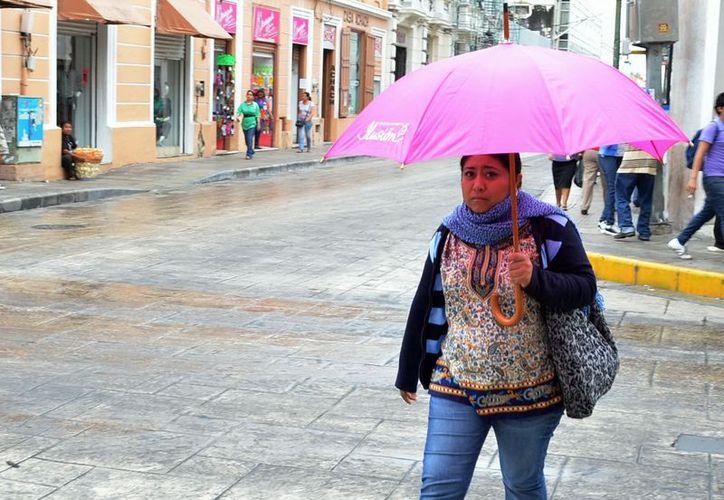 Protección Civil recomienda a la población mantenerse abrigada en esta temporada invernal. Theany Ruz/SIPSE)