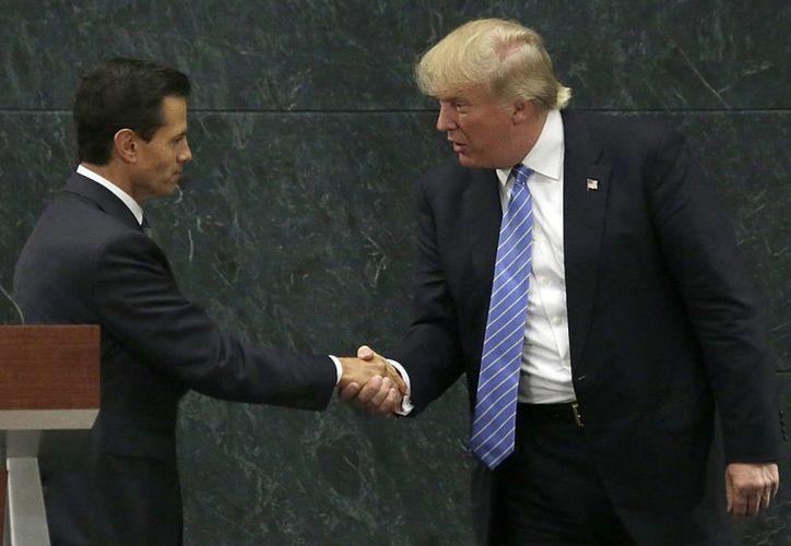 Peña Nieto y Donald Trump tenían programada una reunión el 31 de enero, en la cual hablarían sobre del Tlcan y migración. (Archivo/AP)