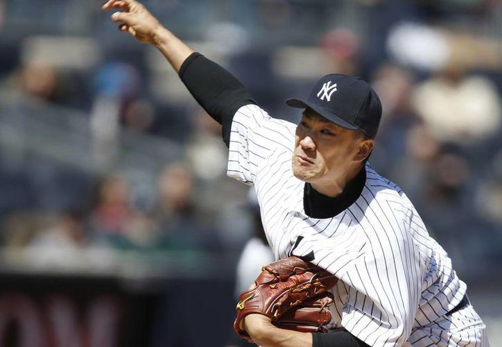 En ocho innings Masahiro Tanaka sólo permitió dos hits con toque de pelota. (Foto: AP)