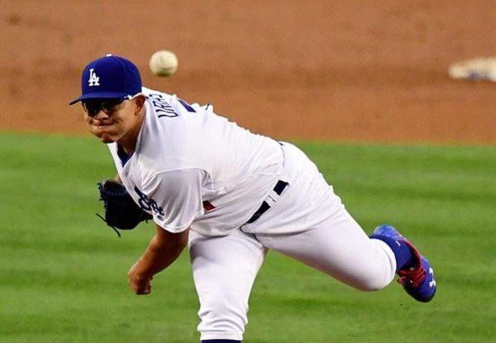 El lanzador mexicano dejó sus números nivelados en 2 victorias y 2 derrotas. Los Dodgers se ponen a un juego del liderato de la división.(Mark J. Terrill/AP)