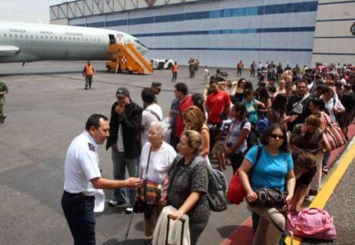 Este martes se utilizan 14 aeronaves para trasladar a más turistas. (Milenio)