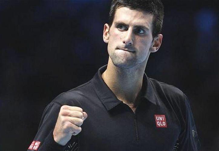 El serbio se colocó en la primera posición después de derrotar a Roger Federer en la final del abierto de Wimbledon. (AP)