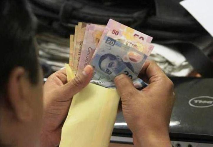 En las empresas privadas se debe pagar al menos 15 días de salario y en el caso de los servidores públicos son 40 días. (Archivo/Sipse)