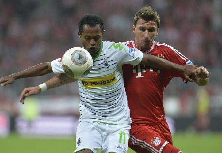 Bayern Munich sumó las primeras tres unidades en la Liga de Alemania tras vencer 3-1 a Borussia. (Agencias)