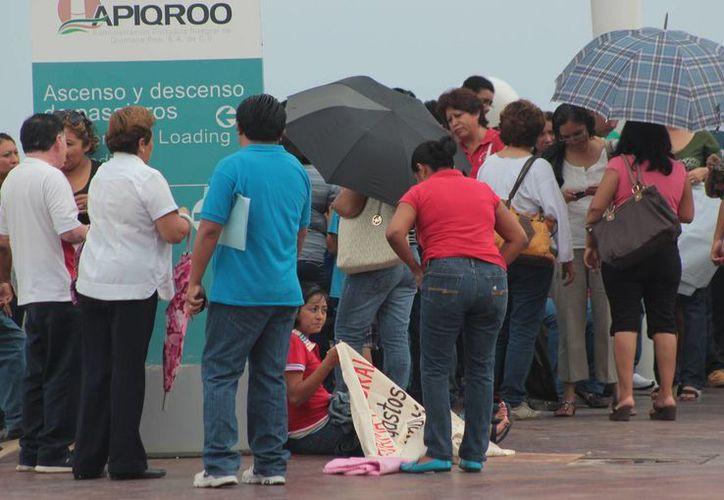 Bloqueo de las intalaciones de la Seqroo causó que el pago de nómina sea hasta el martes. (Gustavo Villegas/SIPSE)