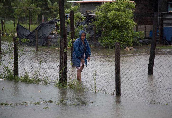 A su paso por Guatemala, la tormenta tropical 'Earl' dejó varias comunidades inundadas. (AP/Luis Soto)