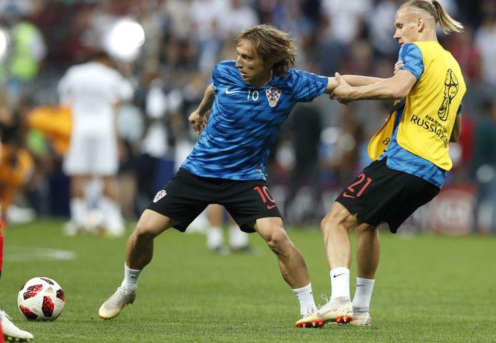 Luka Modric, que ha tenido un gran Mundial, podría ganar el Balón de Oro (Foto AP)