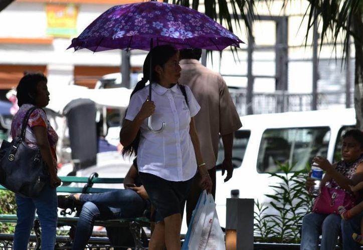 Es posible que el clima sea benévolo con el Desfile Cívico Militar de este viernes por la mañana en Yucatán. El pronóstico del clima indica potencial para tormentas fuertes por la tarde. (SIPSE)