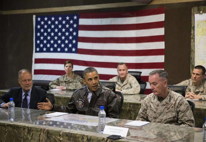 Obama no hizo pública a los medios su visita a las tropas en Afganistán. (AP)