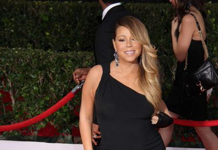 La Cámara de Comercio de Hollywood anunció que Mariah Carey develará en agosto su estrella en el Paseo de la Fama. Será la número 2 mil 556. En la imagen Carey durante la entrega de los premios del Sindicato de Actores de la Pantalla. (Notimex)