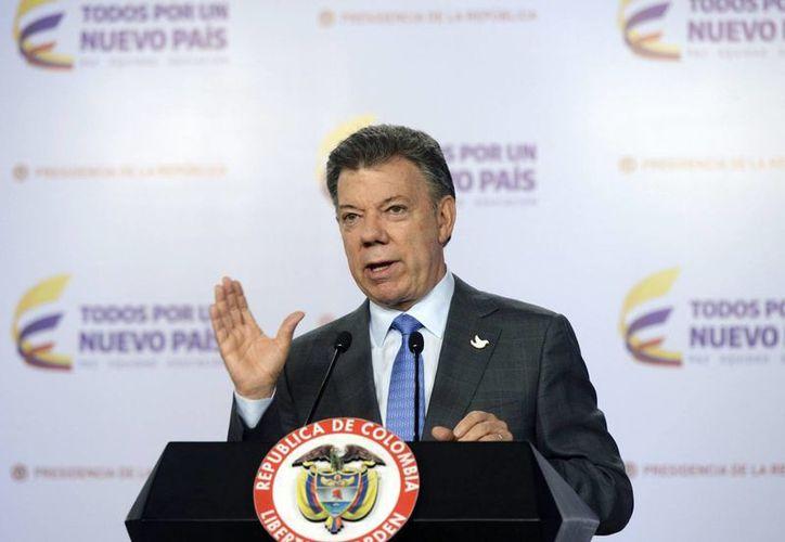 El presidente Juan Manuel Santos negó que su gobierno esté por anunciar el inicio de diálogos formales con el Ejército de Liberación Nacional. (Foto de archivo/Notimex)