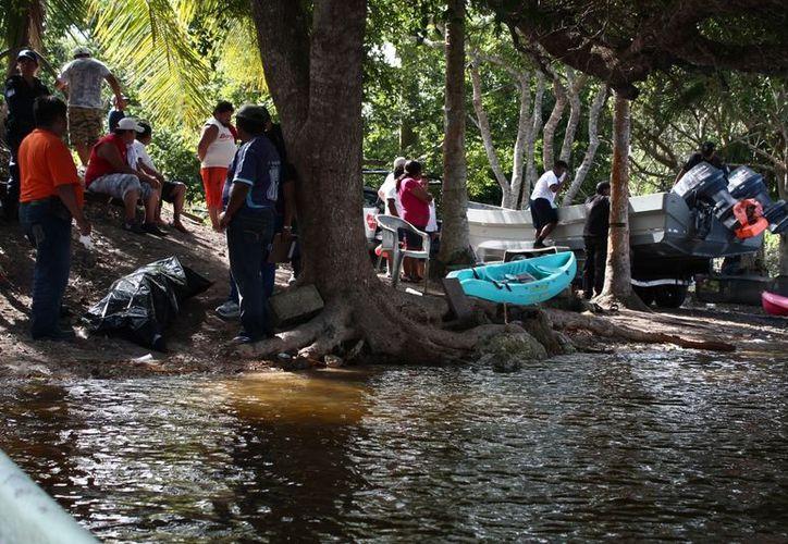 El cuerpo fue trasladado al Servicio Médico Forense para la necropsia de ley. (Juan Carlos Gómez/SIPSE)
