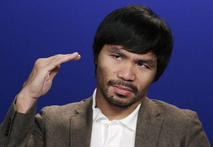 """""""Sigo porque el boxeo es mi pasión"""", dijo Manny Pacquiao, """"pueden verlo en mi cara cada vez que boxeo"""". (AP)"""