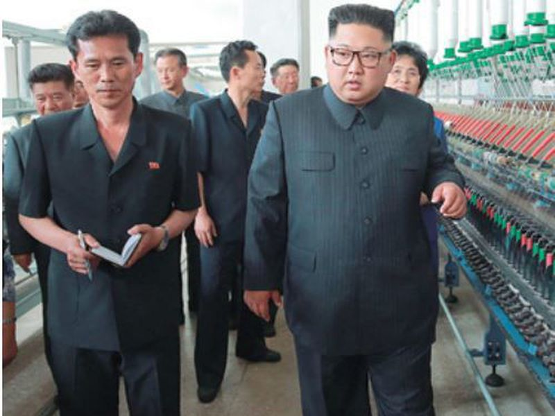 North Korean leader Kim Jong Un, center, visits Sinuiju Chemical Fibre Mill in Sinuiju, North Korea.