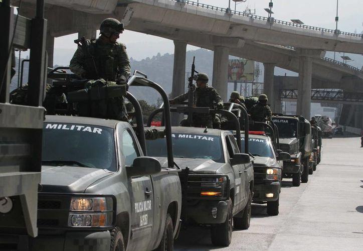 La denuncia de la CNDH dice que se acreditó que 15 militares dispararon en la carretera en Michoacán, lo que tuvo como resultado seis lesionados y un fallecido. Imagen de contexto, solo para fines ilustrativos. (Archivo/Notimex)