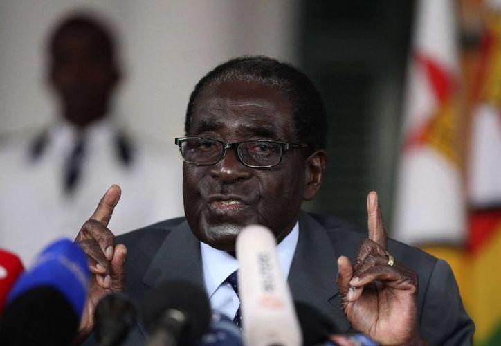 Todavía no está claro si el presidente de Zimbabué, Robert Mugabe, lamenta la desigualdad de género o todo lo contrario. (financialgazette.co.zw)