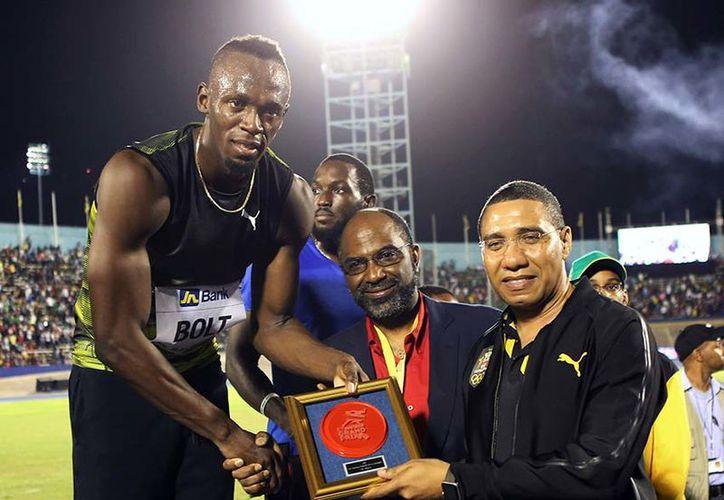 Bolt, de 30 años, es el único corredor que ha ganado las medallas de oro en las carreras de 100 y 200 metros. (Foto: Excélsior)