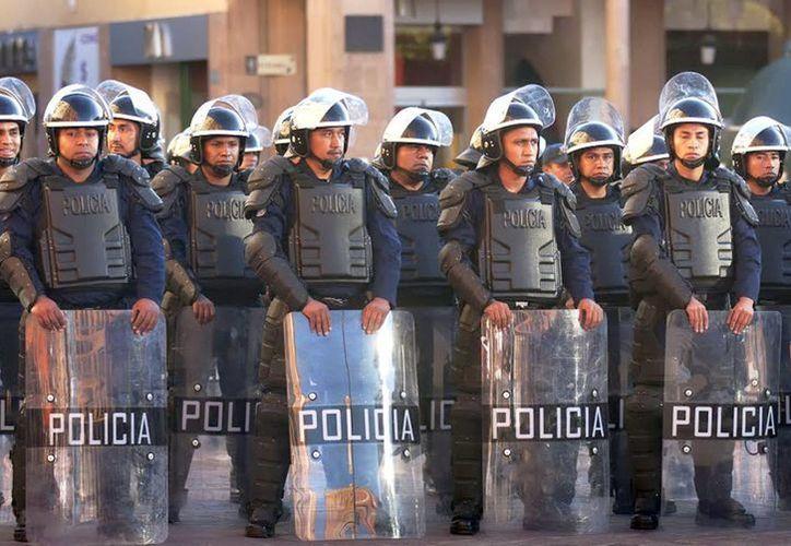 """Policías de Guanajuato fueron entrenados por David Rivas Huete, conocido como el """"mercenario de pastel"""". (Archivo Notimex)"""