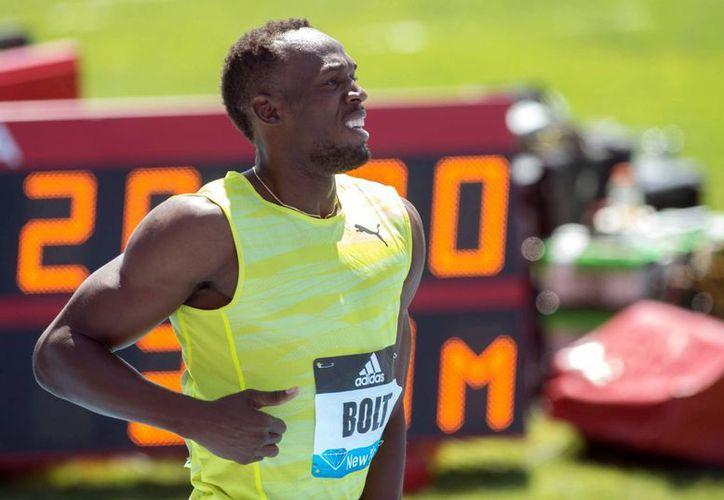 Usain Bolt fue retirado de la lista de competidores en los 100 metros del campeonato nacional de Jamaica. (AP)