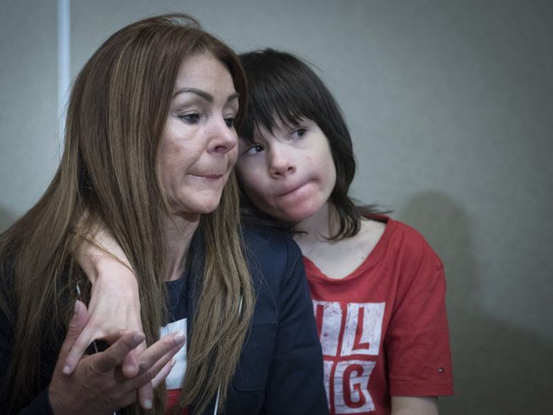 Billy Caldwell sits with his mother Charlotte. (AP)