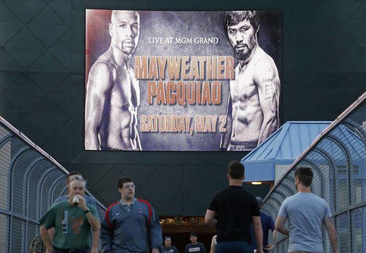 En cuestión de segundos se agotaron los boletos para la pelea de box entre Floyd Mayweather Jr y Manny Pacquiao, a celebrarse el 2 de mayo. En la foto, un anuncio publicitario en Las Vegas. (Foto: AP)