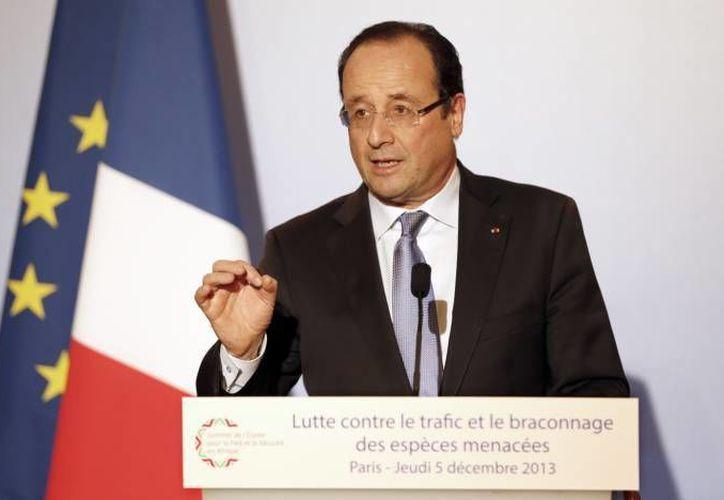 La primera propuesta de impuestos del presidente Hollande no fue aceptada porque podría desatar desigualdades en el fisco francés. (Archivo/SIPSE)