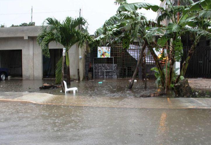 Se realizó el rescate de 14 familias de Coba y San Juan que sufrieron inundación en sus casas. (Rossy López/SIPSE)