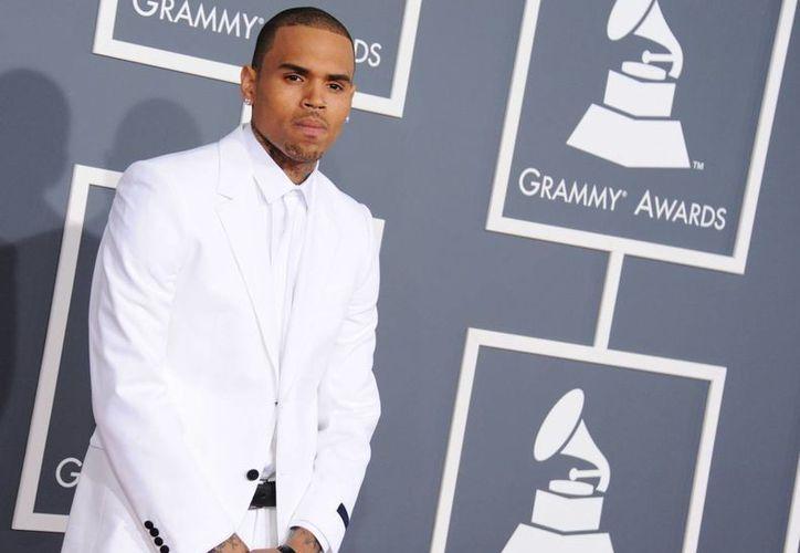 Cuatro años después de golpear a Rihanna, Chris Brown recibió su sentencia. (Agencias)