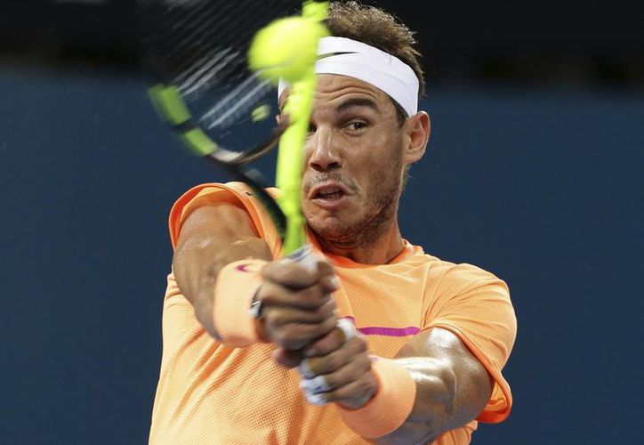 El tenista Rafael Nadal enfrentará en la tercera ronda del Abierto de Brisbane a Milos Raonic.(Tertius Pickard/AP)