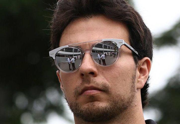 'Checo' Pérez, piloto mexicano de Fórmula 1, de la escudería Force India, frenó la producción de 20 mil pares de lentes Hawkers, que llevaban su nombre, tras cancelar un contrato con la firma. (Archivo/AP)